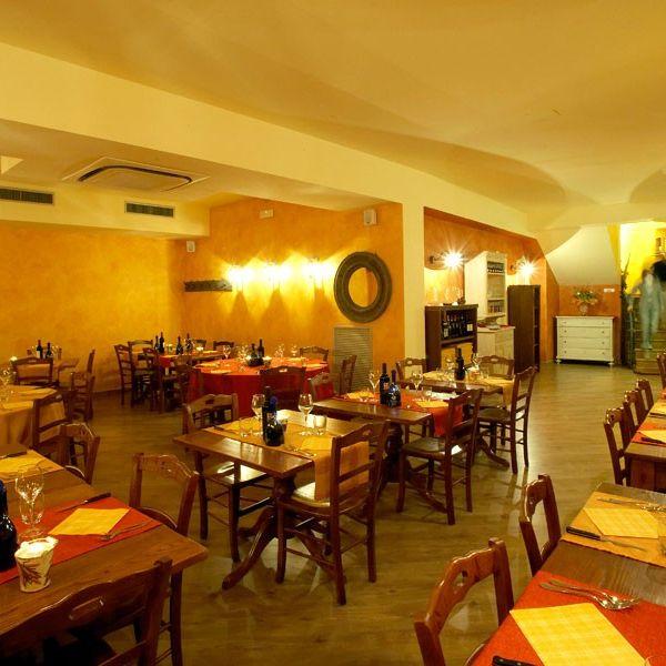 Logo la taverna di casa norcia Assisi Perugia Umbria